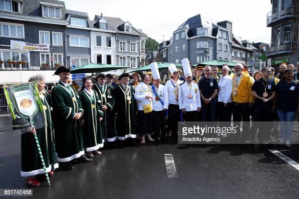 Members of the World Brotherhood of the Huge Omelet gather to cook a giant omlette within a 4 metre diameter frying pan in Malmedy Belgium on August...
