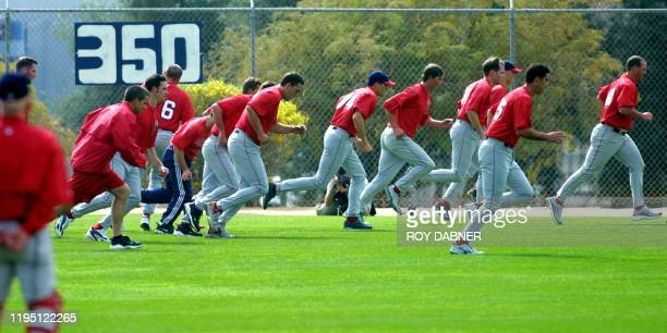 Members of the world champion Anaheim Angels finish their first day of spring training with running exercises 15 February in Tempe Arizona AFP...
