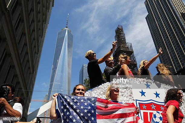 Members of the World Cupwinning US women's soccer cheer as they make their way up The Canyon of Heroes along Broadway during a tickertape parade on...