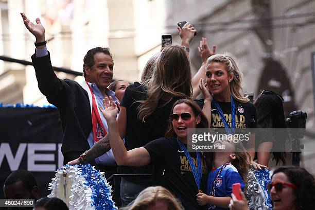 Members of the World Cupwinning US women's soccer team celebrate as they make their way up the The Canyon of Heroes along Broadway during a...