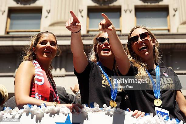 Members of the World Cupwinning US women's soccer team including Whitney Engen are viewed as crowds cheer as they make their way up The Canyon of...