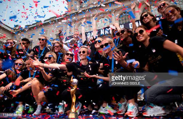 Members of the World Cupwinning US women's team take part in a ticker tape parade for the women's World Cup champions on July 10 2019 in New York...