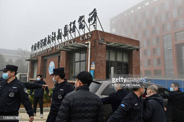 Members of the World Health Organization team investigating the origins of the COVID-19 coronavirus, arrive at the Wuhan Institute of Virology in...