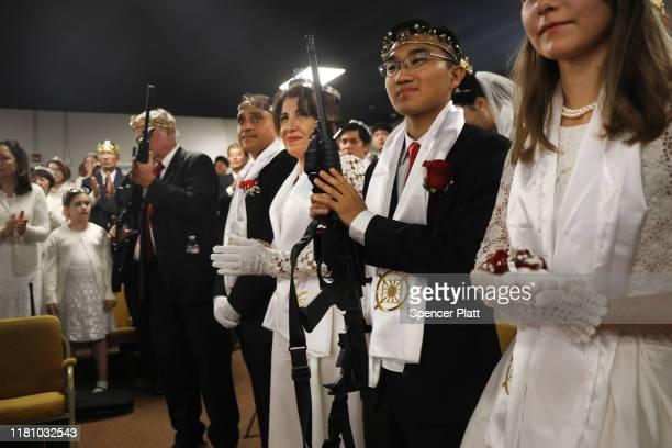 Members of the World Peace and Unification Sanctuary hold their AR-15 rifles as they participate in a Life Holy Marriage Blessing at the church on...