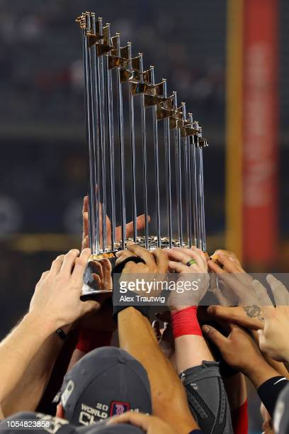 Members of the World Series champion Boston Red Sox hold up the World Series trophy after defeating the Los Angeles Dodgers in Game 5 of the 2018...