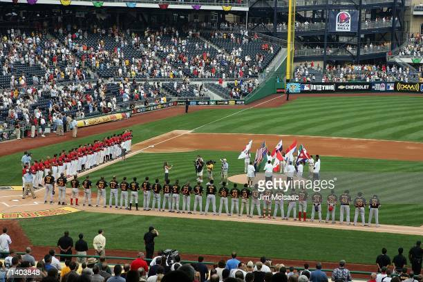 Members of the World Team and members of the U.S.A. Team line up prior to the start of the XM Satellite Radio All-Star Futures Game at PNC Park on...