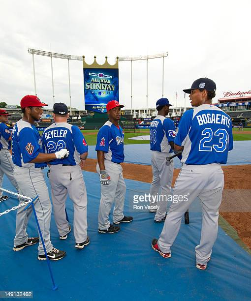 Members of the World Team Futures look on during batting practice before the 2012 SiriusXM AllStar Futures Game against the US Team at Kauffman...
