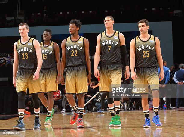 4e290ebc487 ... BBVA Compass Rising Stars Challenge. Editorial use only. Members of the World  Team look on Mario Hezonja Clint Capela Andrew Wiggins Dwight Powell and