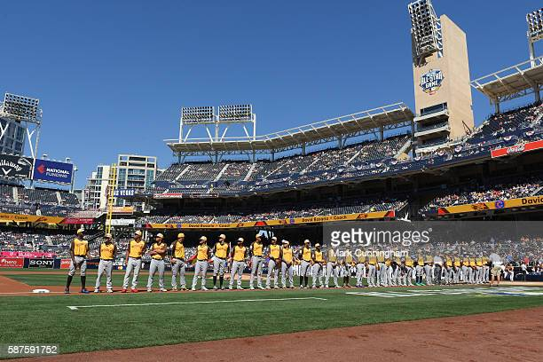 Members of the World Team stand together on the field during player introductions prior to the SiriusXM AllStar Futures Game at PETCO Park on July 10...