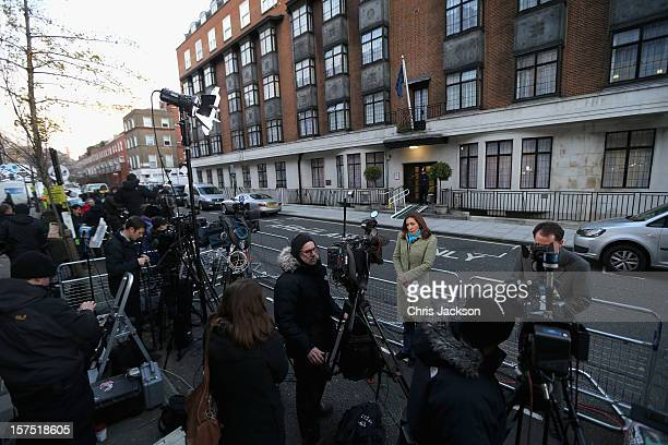 Members of the world's media gather as a policeman stands guard in the early morning at the King Edward VII Private Hospital on December 4 2012 in...