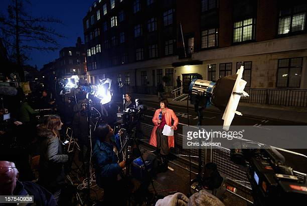 Members of the World's media gather as two Policemen stand guard in the early evening at the King Edward VII Private Hospital on December 4 2012 in...