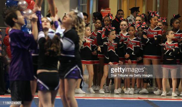 Members of the WTTC from Waterloo Iowa junior level 2 team competed as the Pierce Athletics team from Freeport Illinois waited during the 2013 Spirit...