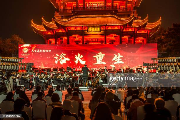 Members of the Wuhan Philharmonic Orchestra perform during a concert at the Yellow Crane Tower Park on November 3, 2020 in Wuhan, Hubei Province of...