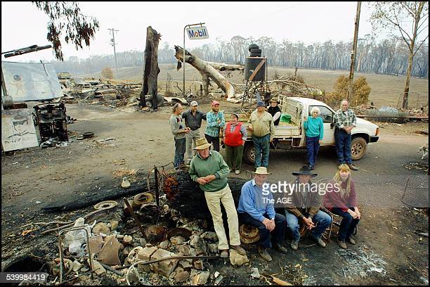 Members of the Wulgulmerang community at the burnt-out site of the Seldom Seen service station. Eight out of 18 homes were burnt. Front- Blue...
