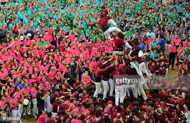 TOPSHOT Members of the Xics de Granollers human tower team fall as they attempt to form a castell during the XXVI human towers or castells...
