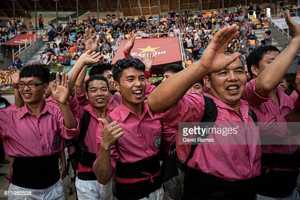 Members of the 'Xiquets de Hanghzou' celebrare as they arrives at the arena during the 26th Tarragona Competition on October 1 2016 in Tarragona...