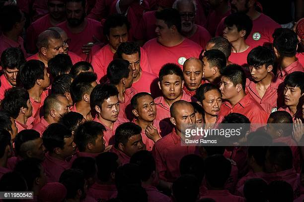 Members of the 'Xiquets de Hanghzou' look on during the 26th Tarragona Competition on October 1 2016 in Tarragona Spain The 'Xiquets de Hanghzou' is...