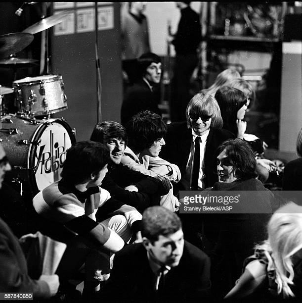 Members of The Yardbirds and the Kinks on set during rehearsals for TV show Ready Steady Go Wembley Studios London 1965 LR Pete Quaife Jim McCarty...