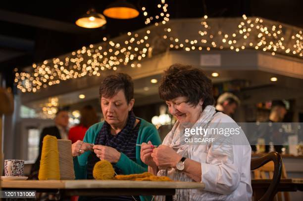 Members of the Yarn Group Liz Smith and Jackie Candlish knit in the bar area of the communityowned Ye Olde Cross pub in Ryton village near Newcastle...