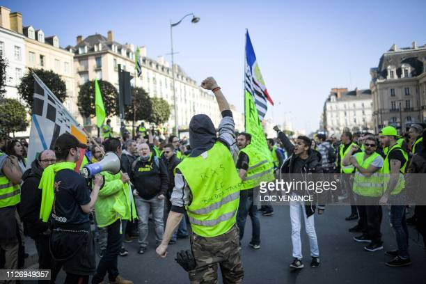 TOPSHOT Members of the yellow vest take part in the 15th consecutive Saturday of demonstrations in Rennes western France on February 23 2019...