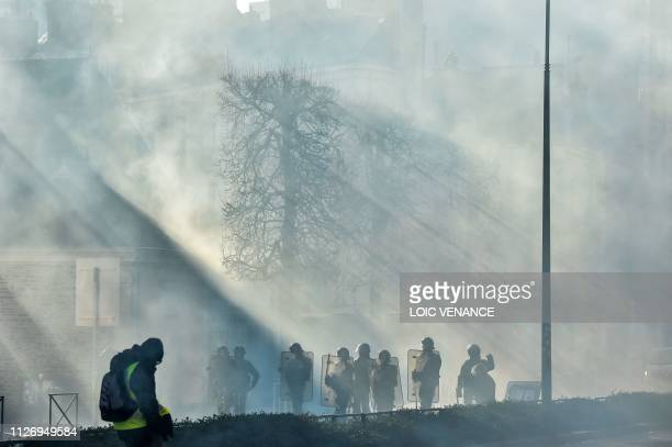 Members of the yellow vest take part in the 15th consecutive Saturday of demonstrations in Rennes western France on February 23 2019 Demonstrators...