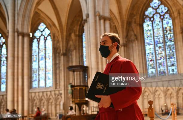 Members of the York Minster Choir perform specially commissioned anthems to mark the resumption of choral signing at York Minster in northern England...