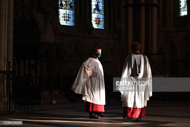 Members of the York Minster Choir prepare to perform specially commissioned anthems to mark the resumption of choral signing at York Minster in...