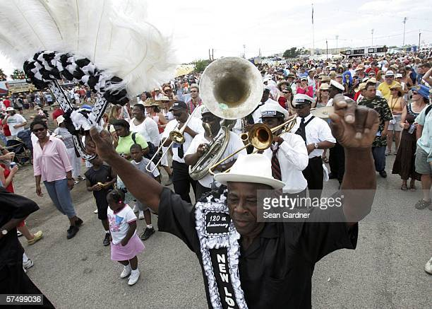 Members of the Young Olympia Aid and New Look Social Aid Pleasure Clubs with Paulin Brothers Brass Band parade through out the crowd during the New...