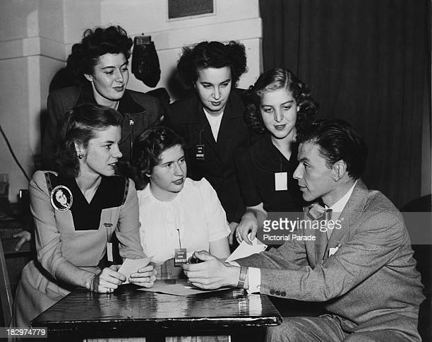 Members of the Young Voters for Roosevelt Committee discuss a forthcoming youth rally with guest speaker American actor and singer Frank Sinatra...
