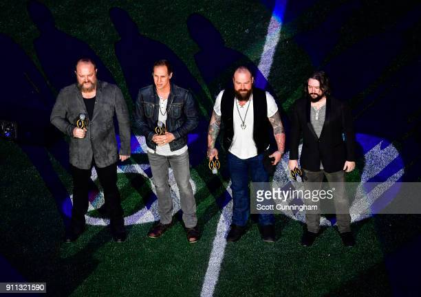 Members of The Zac Brown Band perform the national anthem before CFP the National Championship presented by ATT between the Alabama Crimson Tide and...