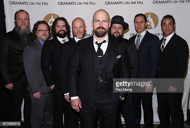 Members of the Zac Brown Band pose for a photo at the GRAMMYs on The Hill Dinner at The Hamilton on April 13 2016 in Washington DC