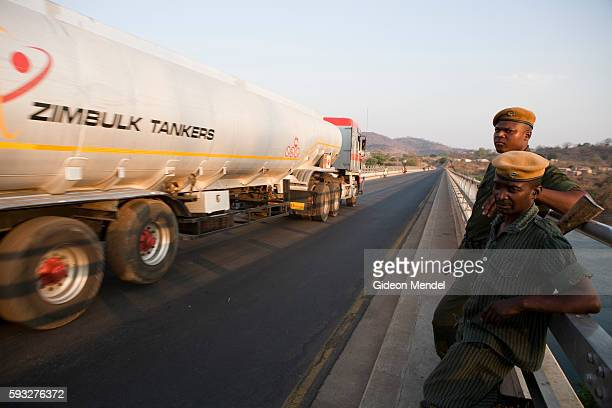 Members of the Zambian paramilitary border police monitor traffic and patrol the bridge which spans the Zambezi River between Zambia and Zimbabwe at...