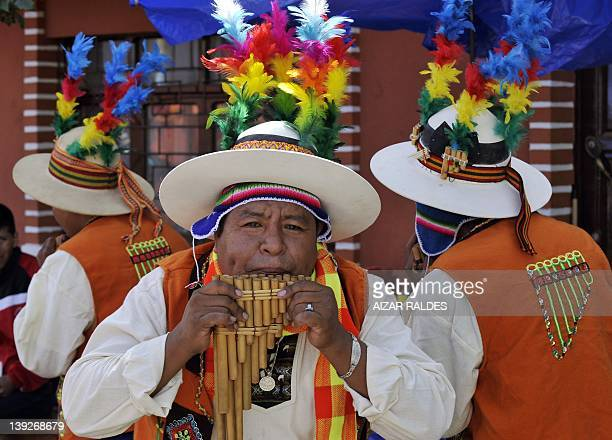 Members of the Zamponeros Hijos del Pagador carnival group parade during the Carnival of Oruro in the mining town of Oruro 240 km south of La Paz on...