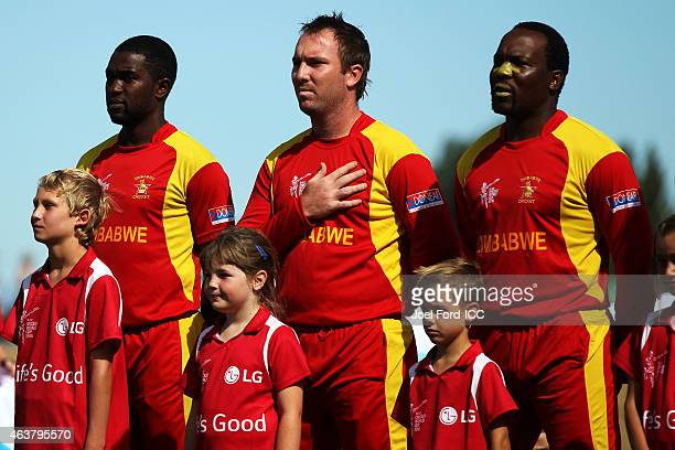 Members of the Zimbabwe cricket team during national anthems at the 2015 ICC Cricket World Cup match between Zimbabwe and the United Arab Emirates at...