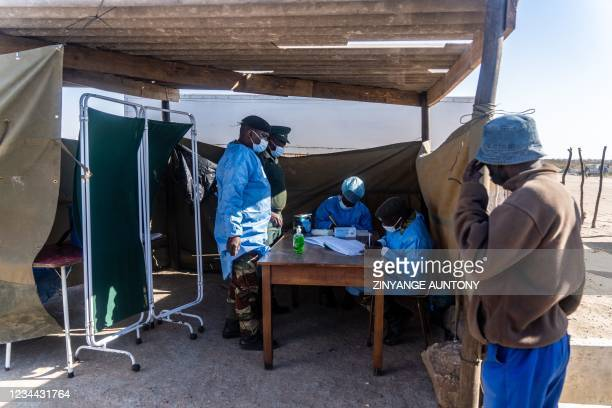 Members of the Zimbabwe National Army during a community outreach vaccination program on 3 August 2021, in Cowdray Park township, Bulawayo, Zimbabwe....