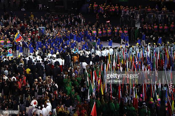 Members of ther Venezuela team enter the stadium during the Opening Ceremony of the Rio 2016 Olympic Games at Maracana Stadium on August 5, 2016 in...