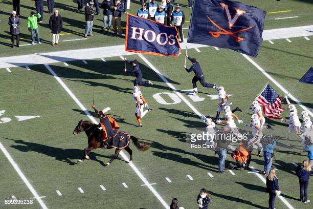 Members of theVirginia Cavaliers take the field before the start of the Military Bowl at NavyMarine Corps Memorial Stadium on December 28 2017 in...