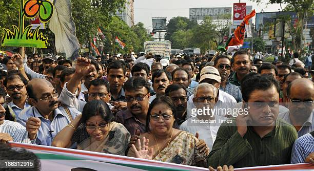 Members of TMC teachers wing along with State Education minister Bratya Basu stage a protest rally against the heckling of Chief Minister Mamata...