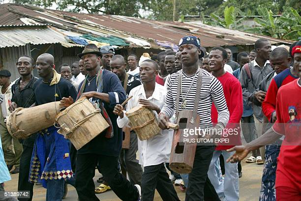 Members of Tom Ateke's militia Niger Delta Vigilante Service take part in a peace rally in Okrika 04 October 2004 Tom Ateke a warlord who has battled...