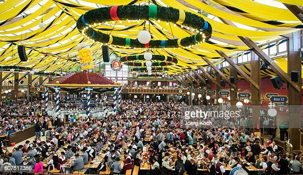 Members of traditional Bavarian costume associations Bavarian bands and riflemen's associations have taken place in the Paulaner beer tent after they...