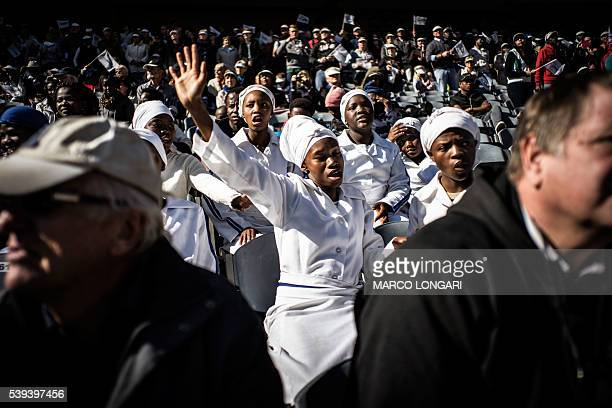 TOPSHOT Members of traditional churches pray at the Orlando Stadium in Soweto on June 11 2016 during a ceremony to commemorate the 40th anniversary...