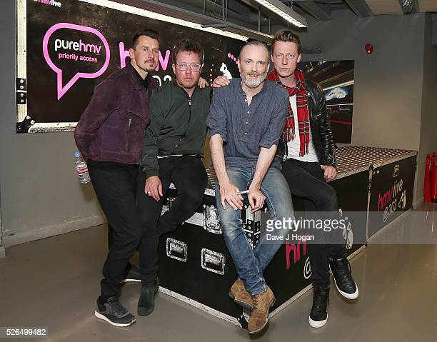Members of Travis pose for a photo after performing songs from their new album Everything At Once at HMV Oxford Street on April 30 2016 in London...