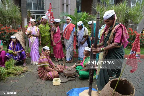 Members of tribal community celebrate Jagatik Mulnivasi Adivasi Day by taking out procession and displaying their culture at Vashi on the occasion of...