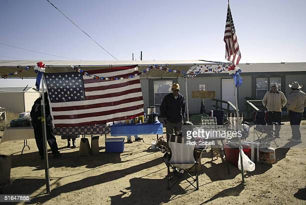 Members of tribal presidential incumbent Tony Serento's camp set up temporary headquarters outside of the To'hajiilee polling center as the Navajo...
