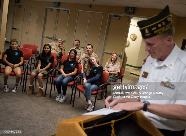 Members of Troop 7272 watch as Jim Clements Scout Chairman for VFW Post 6024 in Mission Viejo signs their charter application during a ceremony at...