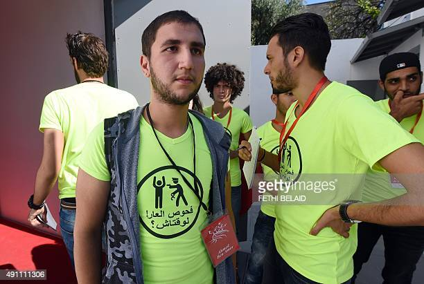 Members of Tunisian 'Shams' association for the decriminalisation of homosexuality including its vice president Ahmed Ben Amor wait before a press...