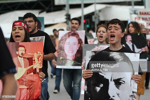 Members of Turkey's Alevi community shout slogans as they march in Ankara on July 2, 2015 to mark the 22nd anniversary of an arson attack on Madimak...