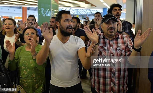 Members of Turkey's main opposition party Republican People's Party applaud during a rally to denounce corruption outside a business mall in Ankara...