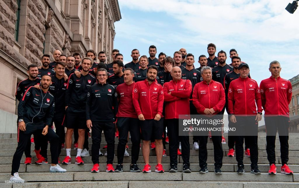 Members of Turkey's national football team pose for a group photo during a walk in the streets of Stockholm ahead of the UEFA Nations League football match between Sweden v Turkey on September 10, 2018.