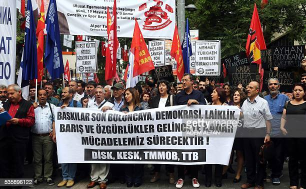 Members of Turkeys opposition unions and civil servant groups stage a protest against the Turkish government's policies which they accuse of being...